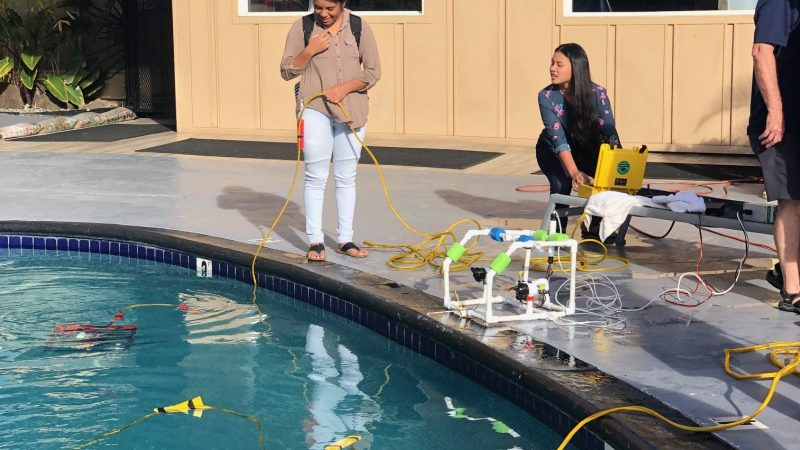 Students Operating ROVs In A Pool.